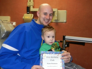 Mylan Hammons with his father, Brett Hammons, has his first visit to the dentist at age one!